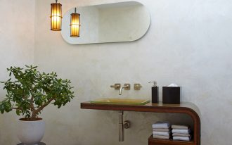 contemporary bathroom vanity wall mounted wood vanity with glass sink and separated cabinets black accent table white pot for jade plants red tiled floors warm lighted lamp