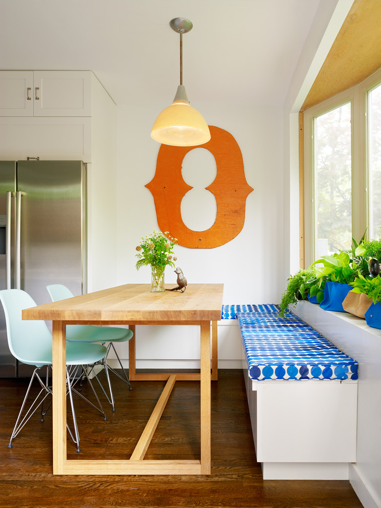 contemporary dining nook vintage inspired pendant in orange light wood dining table light turquoise chairs built in bench seat with blue motifs