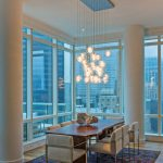 Contemporary Dining Space Blown Glass Pendants With Longer Wires Butcher Block Dining Table Contemporary Dining Chairs Multicolored Rug Wood Floors