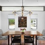 Contemporary Dining Spot Wood Dining Table Black Painted Wood Dining Chairs Monochromatic Dining Chairs With Clear Acrylic Legs Trendy And Modern Light Fixture
