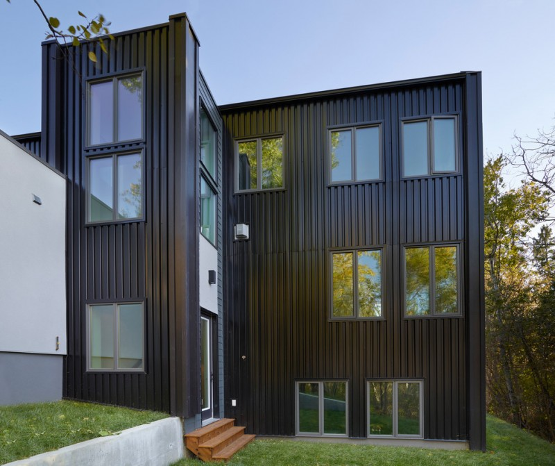 contemporary exterior design black & vertically textured exterior walls glass windows with black trims exterior wood stairs
