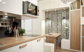 contemporary kitchen design wall mounted wood table black wallpaper with flower motifs wooden floors wooden countertop white cabinets flat panel upper cabinets
