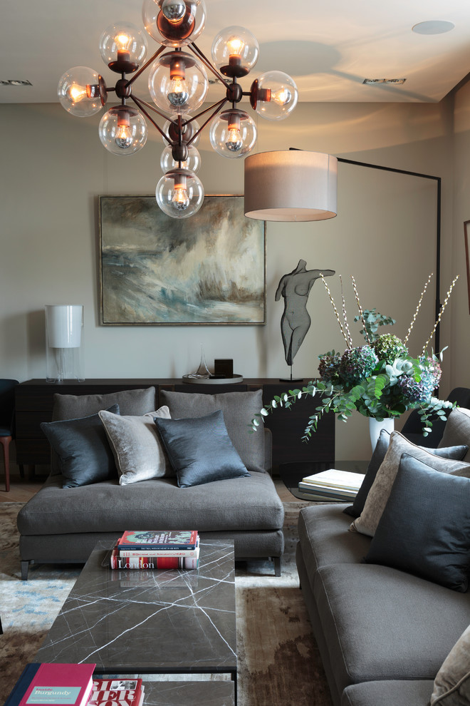 contemporary living room gray loveseat with throw pillows a cluster of modern bubles with low lighted LED inside