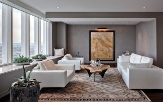 contemporary living room idea gray wall color large glass windows purely white couches log top coffee table with mertal legs tuscan area rug dark wood floors
