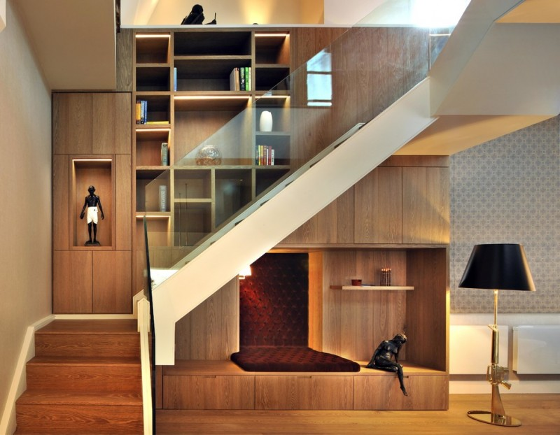 contemporary staircase with frameless glass railings recessed shelving unit little reading corner under staircase