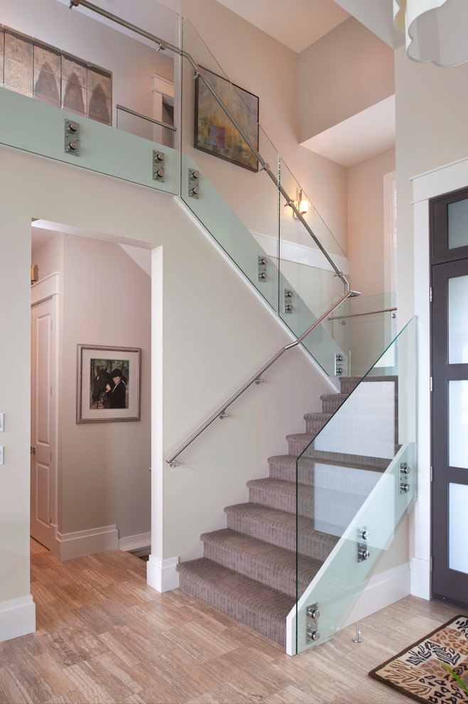 contemporary staircase with metal and glass railings
