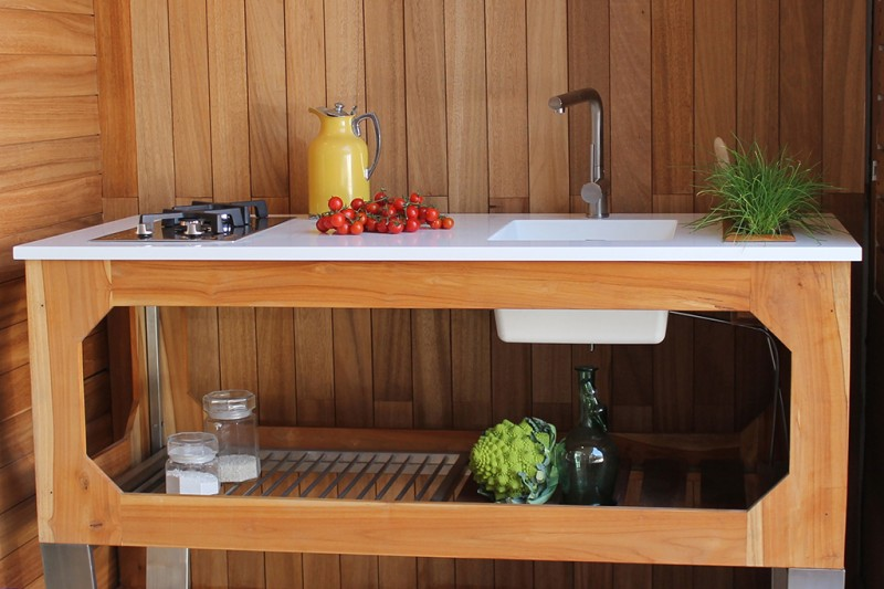 contemporary wooden freestanding kitchen sink design with under open shelf gloss white countertop deeper farmhouse sink and planted stove