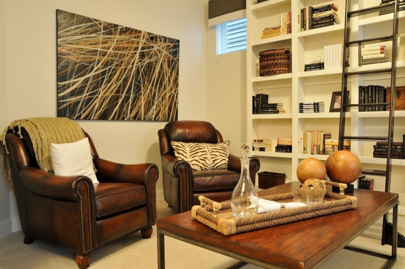 dark brown leather recliners green blanket throw pillows wooden coffee table creative abstract painting full height shelves in white