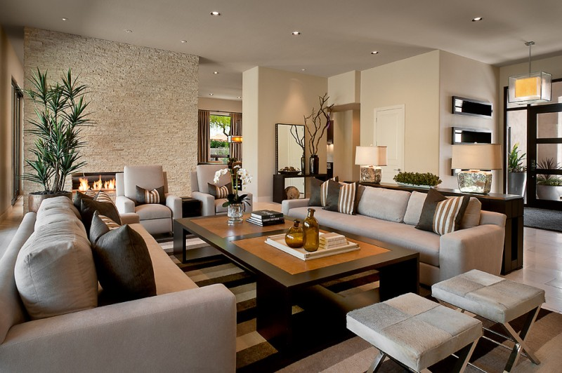 formal & contemporary living room textured & light brown wall color formal sofas in grey dark brown coffee table