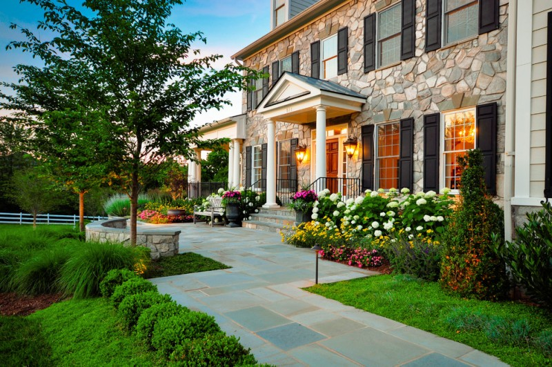 formal walkway with concrete hardscaping and formal front garden