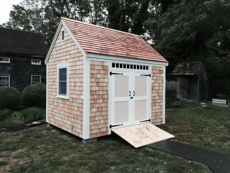 light toned rustic shed idea with white trimed window and door