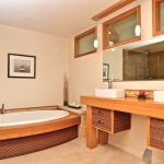 master bathroom in Asian style bamboo finishing cabinets hardwood bathroom vanity oval bathtub with bamboo accent