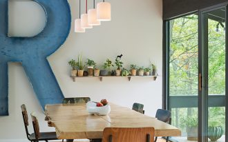 mid century modern dining room giant decorative R in blue industrial dining furniture wood reclaimed floors small planthouse in pots