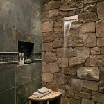 Modern Bathroom Idea Natural Stone Wall Dark Tiled Floors And Walls Corner Wood Bench Waterfall Shower Head