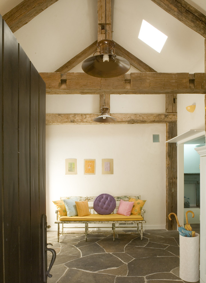 modern farmhouse interior white concrete walls wooden ceiling beams vintage bench in yellow slate flagstone floors