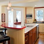 Modern Home Bar With White Wainscoating Back And Red Top White Top Kitchen Sink With Wooden Cabinets Stained Glass Pendants
