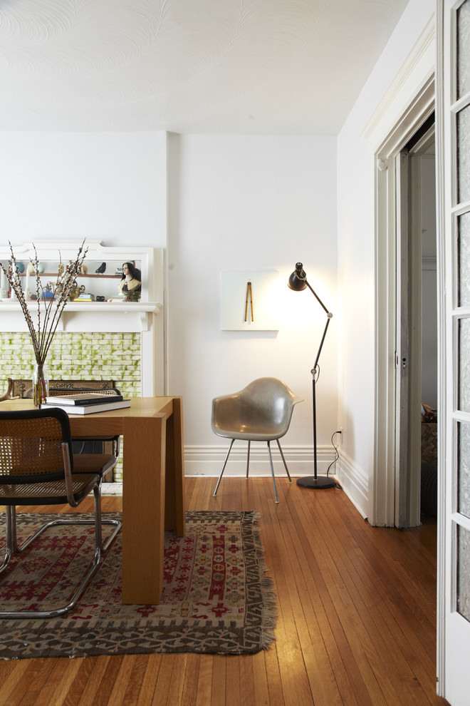 modern home office idea with tiny reading nook wooden office desk vintage area rug medium wood plank floors mid century modern chair modern floor lamp