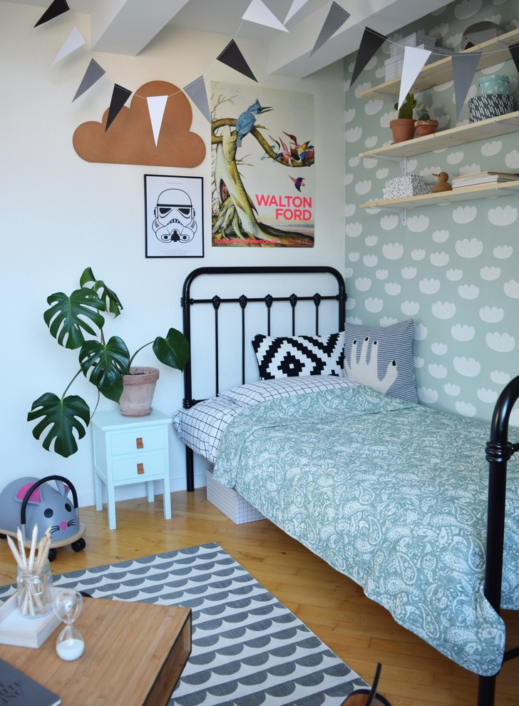 modern kids bedroom classic black bed frame with headboard smaller white bedside table houseplant on clay burnt pot light wood floors modern rug cloud shaped wallpaper