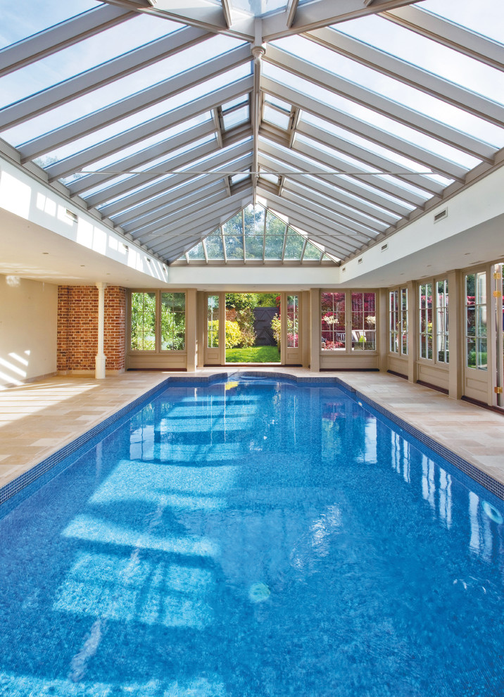 modern pool arched ceilings with full skylights and exposed beams