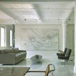 Museum Like Living Room White Wall Color Light Gray Couch Black Chairs Darker Glass Coffee Table With Oval Shaped Top