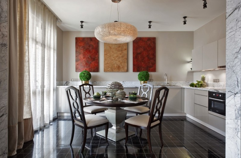 open concept kitchen with dining space woven wood pendant in circle shape traditional dining chairs round top dark wood dining table glossy black tiled floors