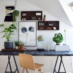 Scandinavian Home Office Blackwashed Working Table Light Wood Working Chair In Modern Style Floating Wood Shelves Monochromatic Handpainting Some Jade Plants