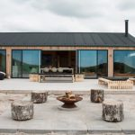 Scandinavian Inspired Contemporary Exterior House Wood Planks Exterior Walls Large Glass Windows And Sliding Door Black Finished Roofs Concrete Floors