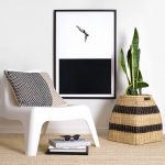 Simple Modern Reading Nook White Chair With Throw Pillow Wood Knitted Basket For Housplant Monochromatic Wall Art