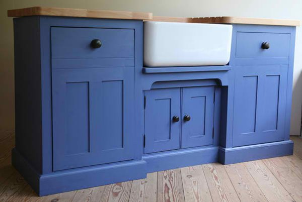 simple & traditional freestanding kitchen sink cabinet with blue cabinets white farmhouse sink and wooden countertop