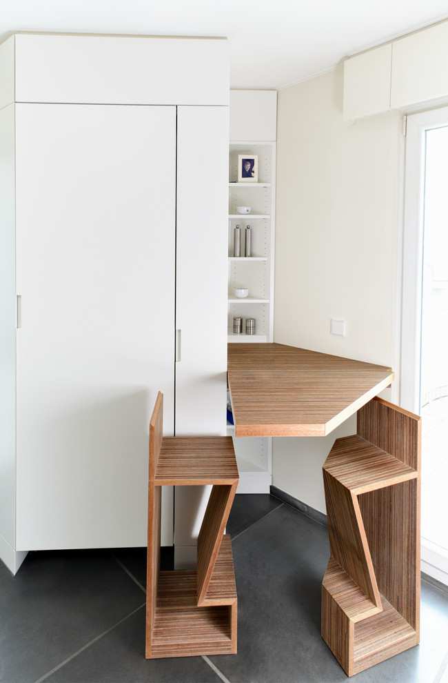 small & compact cooking zone idea unique shaped wood folded dining table unique wood chairs white flat panel cabinet recessed shelves