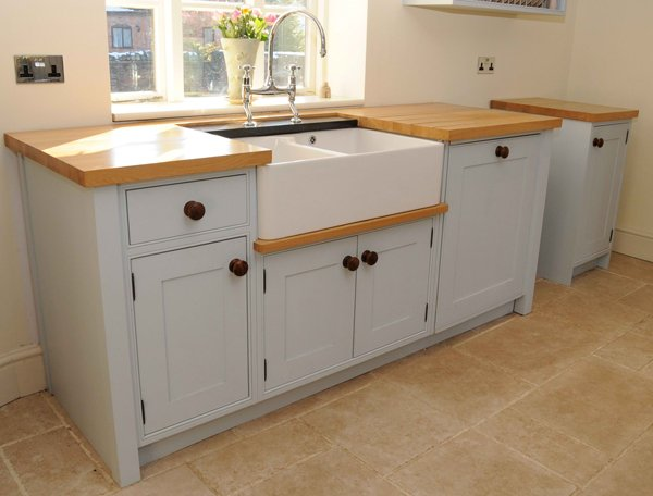 traditional freestanding kitchen sink cabinet with light wood countertop white farmhouse sink white cabinets stainless steel faucet