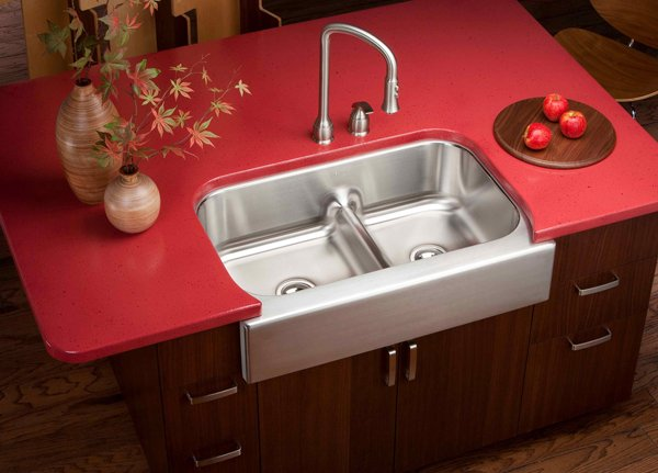 traditional freestanding kitchen sink cabinet with red countertop dark wood cabinets stainless steel faucet and double stainless steel sinks