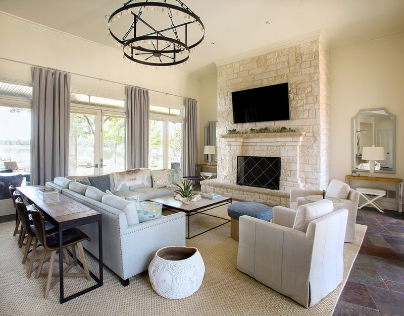 transitional living room light cream wall color light cream bricks for fireplace's surrounding light blue sofa white slipcover chair woven area rug slate floors