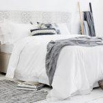 Scandinavian Moroccan Bedroom Idea White Bedding Treatment Stripped Monochromatic Bed Mat Beige Moroccan Side Table Geometric Tiled Walls