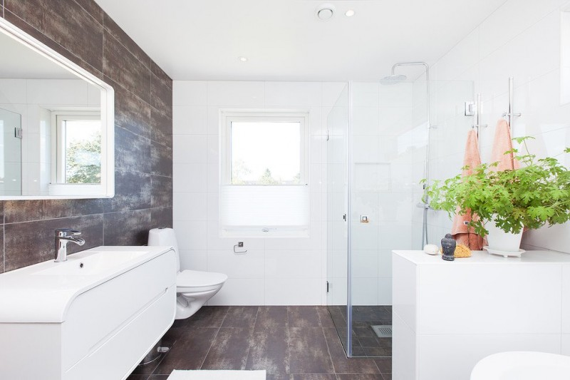 Scandinavian bathroom dark wood reclaimed floor and wall floating vanity in white large frameless mirror walk in shower with clear glass panels little greenery