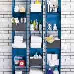 Blue Powdercoat Shelving Units White Subway Tiled Wall Concrete Floors