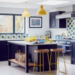 Colorful Seashell Patterned Backsplash Black Kitchen Island With White Top Wood Top Stools With Yellow Hairpin Legs Pendants With Yellow Lampshades