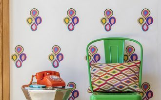 colorful teardrops wallpaper idea bold green plastic chair unique silver side table vintage telephone in orange round shaped wall clock with green frame