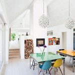 Contemporary Dining Space Colorful & Rainbow Dining Furniture Set Crystal Chandeliers Fresh Flowers Colorful Artwork White Walls And Floors