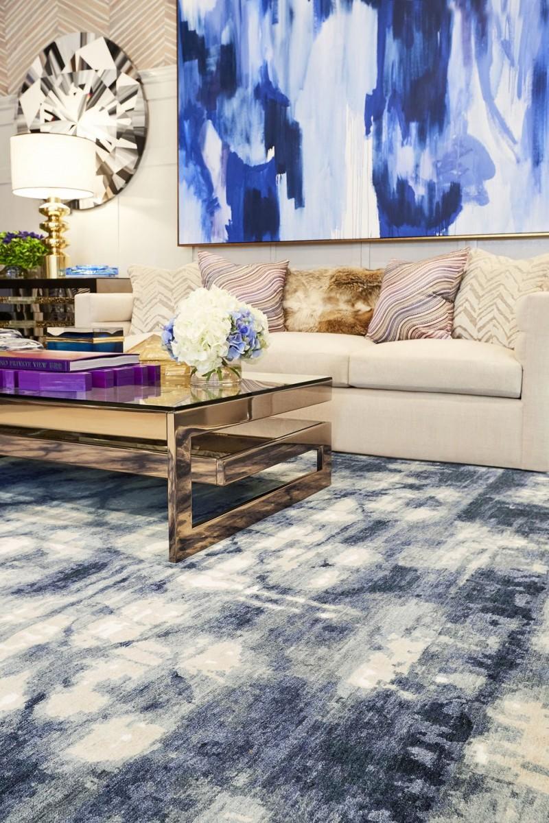 contemporary living room warm toned sofa striped throw pillows contemporary coffee table blue indigo carpet