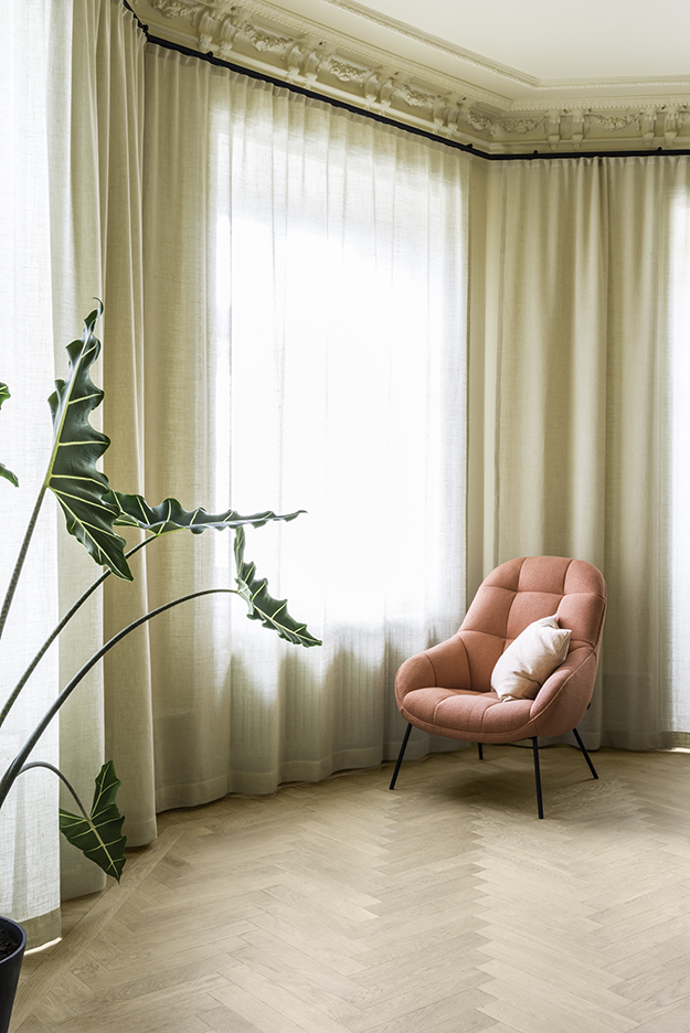 full height window curtains in yellowish white dimmer red chair with tufted cover light wood floors