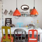 Fun Industrial Style Dining Room Rainbow Dining Chairs White Dining Table Industrial Style Pendants With Pop Of Orange Color White Wood Plank Walls And Floors