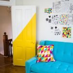 Half Way Painted Door In Yellow And White Blue Radiance Sofa Multicolored Throw Pillow Cowhide Rug Medium Toned Wood Floors