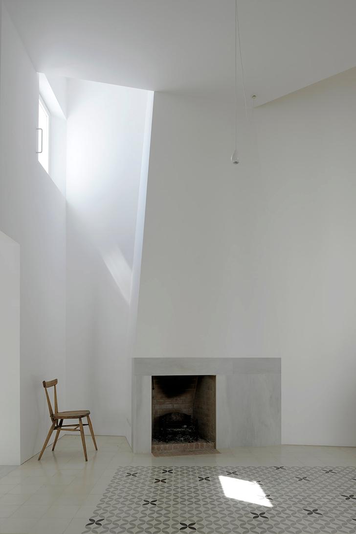 large Scandinavian living room wood chair built in fireplace Monaco carpet upper glass window purely white walls white ceramic floors