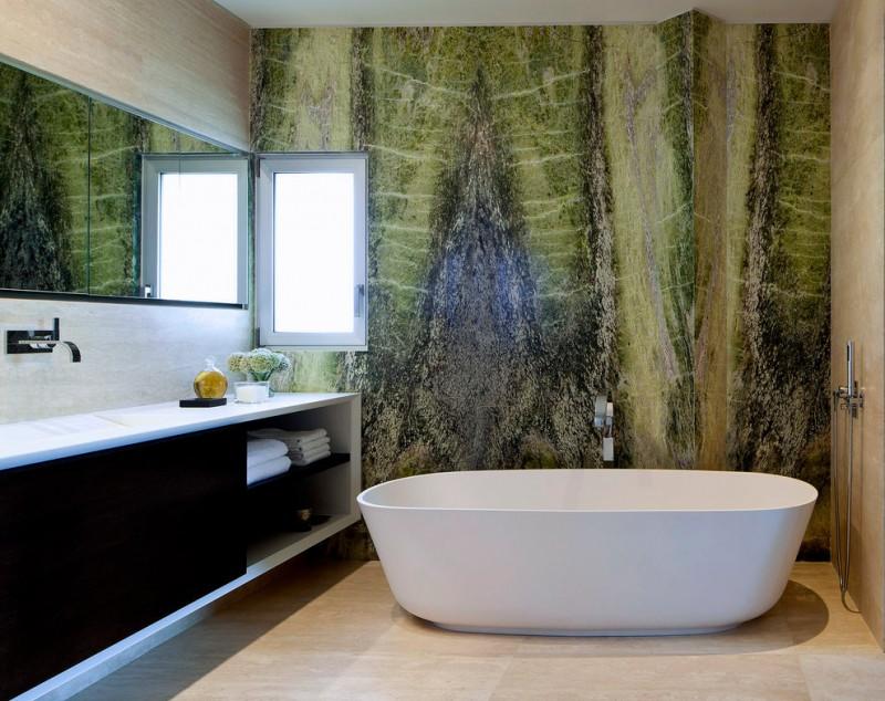 modern bathroom green marble walls white freestanding bathtub light cream floors bathroom vanity with white counter and open shelves white ceramice tile backsplash