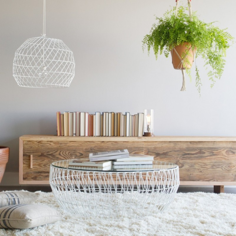 modern bohemian reading nook round glass top coffee table with white wire base white shag rug modern wood hall console hanging greenery pendant with white wire lampshade