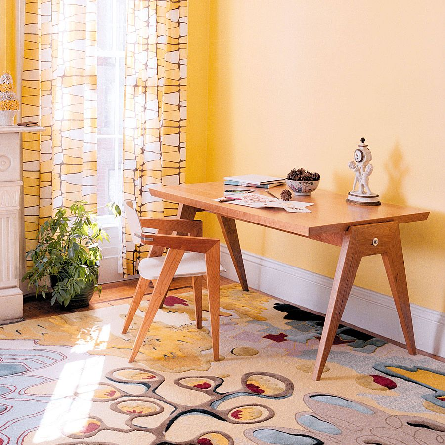 modern home office design yellow curtains with pattern multicolored carpet with pattern wood working desk wood working chair