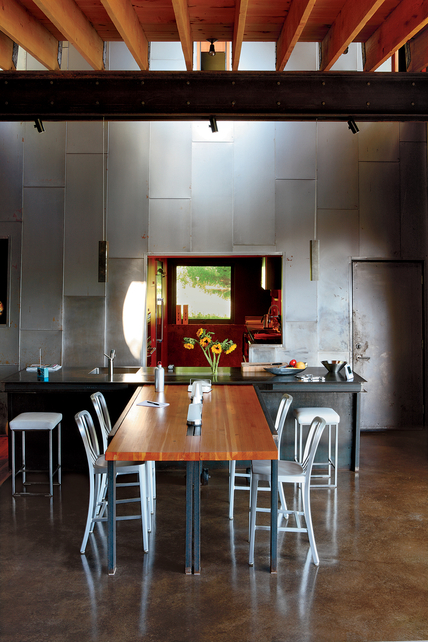 modern industrial dining room iron planks wall white modern dining chairs modern wood dining table exposed iron beams dark neutral floors