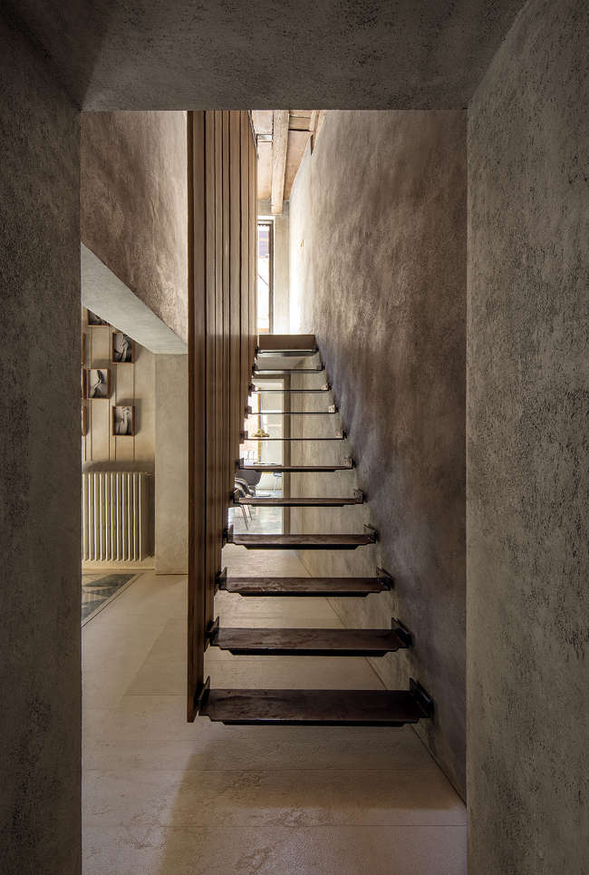 modern interior stairs with base to top wood plank railings wall mounted steps concrete walls