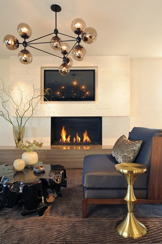 modern living room single chair in leather finishing gold toned metal side table glossy black finish log coffee table brass finish pendant in modern style modern fireplace